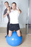 Core stability. Physical therapist with patient in a gym Stock Images