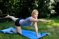 Core strength exercise - blond woman Royalty Free Stock Photos