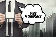 Core technology text on speech bubble with businessman Stock Photos