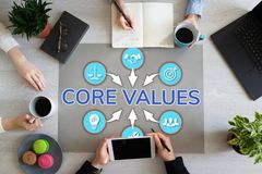 Core values. Business people teamwork in office. Wooden table top view. stock photos