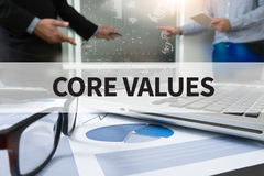CORE VALUES. Businessman making presentation with his colleagues and business strategy digital layer effect at the office as concept Royalty Free Stock Images