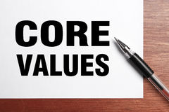 Core Values. Text is on white paper with black pen aside stock images