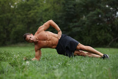 Core workout. Core strength exercises in the park stock photo