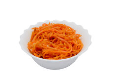 Corean carrot salad. Tasty corean salad on plate on white background stock image