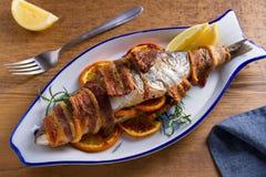 Coregone Bacon-avvolto arrostito Il pesce si ? avvolto con bacon immagini stock libere da diritti