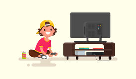 Мальчик играя видеоигры на консоли игры также вектор иллюстрации притяжки corel Стоковое Изображение
