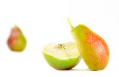 Corella pears on white backdrop Stock Photo