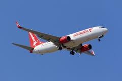 Corendon Airlines 737 på långa finaler Arkivfoton