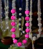 Cores cor-de-rosa dos ornamento com a fotografia escura do fundo Foto de Stock Royalty Free
