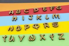 Cores das letras que aprendem o alfabeto de madeira Fotografia de Stock Royalty Free