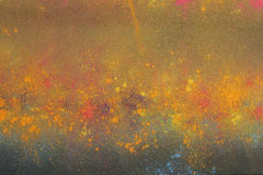 Cores de Holi no fundo preto Fotos de Stock Royalty Free