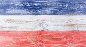 Cores nacionais americanas pintadas em placas de madeira do desvanecimento Fotos de Stock
