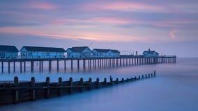 Cores pasteis do nascer do sol do amanhecer em Southwold, Suffolk, Inglaterra fotos de stock