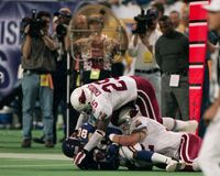 Corey Chavous and Zack Walz tackle Cris Carter. Image taken from color slide royalty free stock photos
