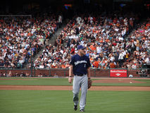 Corey Hart walks to right field to take position Royalty Free Stock Images