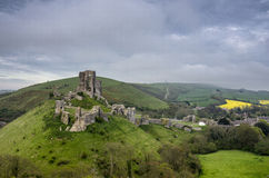 Corfe Castle in Dorset. The ruins of Corfe Castle in Dorset on a blustery spring day Royalty Free Stock Images
