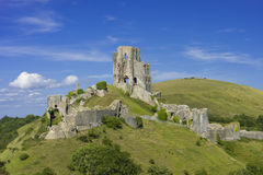 Corfe Castle in Dorset. View of Corfe Castle in the Purbeck Hills of Dorset seen from West Hill stock photography