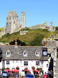 Corfe Castle, Isle of Purbeck, Dorset. Corfe Castle silhouetted against a blue sky in September at Corfe Castle, Dorset, England, UK Royalty Free Stock Images