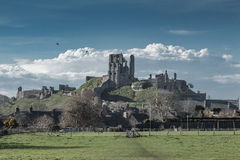 Corfe Castle landscape. The ruins of England's ancient Corfe castle rise above the town of the same name Stock Photo
