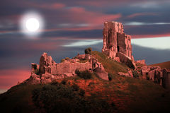 Corfe castle by moonlight and dramatic sky Royalty Free Stock Photos