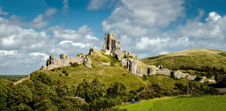 Corfe Castle Panorama. Corfe Castle a medieval castle located in the Purbeck Hills located in Dorset in the South of England Stock Photos