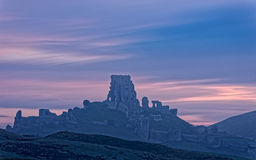 Corfe Castle Ruins in Magical Dawn Light Royalty Free Stock Photos
