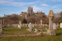 Corfe Castle from the village graveyard. Corfe castle, defended by Lady Bankes for the Royalists during the English civil war and laid waste by the Round Heads Stock Image