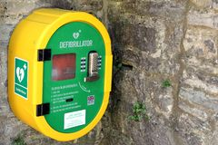Corfe, Dorset, UK - Jun 03 2018: A publicly accessible automated external defibrillator AED on a stone wall, for emergency use i stock photography