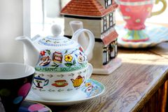 Corfe, England - June 03 2018:Decorative colorful Lapsang Souchon tea pot, on a windowsill with other china items in a tea shop stock image