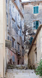 Corfu alley. An alley full of once majestic but now crumbling and dilapidated buildings dating from the Venetian era Stock Photography