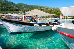 CORFU-AUGUST 26: Boats on the water on the Palaiokastritsa beach on August 26,2014 on the island of Corfu, Greece. Royalty Free Stock Photos