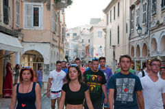 CORFU-AUGUST 22: Kerkyra old town in the evening with the row of souvenirs shops on August 22, 2014 on Corfu island, Greece. Royalty Free Stock Photos