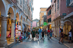 CORFU-AUGUST 22: Kerkyra old town with the row of souvenirs shops on August 22, 2014 on Corfu island, Greece. Royalty Free Stock Photo