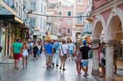 CORFU-AUGUST 22: Kerkyra old town with the row of souvenirs shops on August 22, 2014 on Corfu island, Greece. Royalty Free Stock Photos