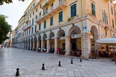 CORFU-AUGUST 22: The Liston of Corfu in Kerkyra city with the row of local restaurants on August 22, 2014 on Corfu island, Greece. Stock Images