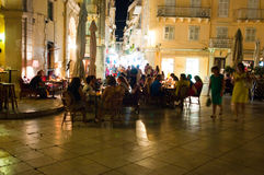 CORFU-AUGUST 25: Nightlife in Kerkyra town, crowd of tourists around on August 25, 2014 on the Corfu island, Greece. Royalty Free Stock Images