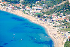 Corfu beach coastline birds eye view. Typical sand beach. Corfu beach coastline birds eye view. Typical sandy beach found in Kerkyra island Stock Image