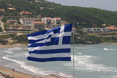 Corfu beach greek flag Royalty Free Stock Image