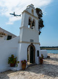 Corfu Church. Church in Corfu with jet flying over royalty free stock photo