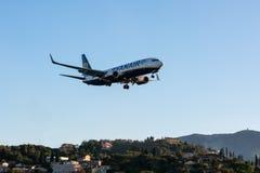 CORFU, GREECE - APRIL 3, 2018: Modern passenger airplane of Ryanair airlines before landing in airport of Corfu island, Greece royalty free stock photos