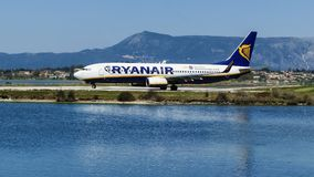 CORFU, GREECE - APRIL 8, 2018: Modern passenger airplane of Ryanair airlines on runway before take off in airport of Corfu island, Royalty Free Stock Photos