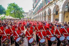 Philharmonic musicians playing in Corfu Easter holiday celebrations among crowd, Ionian, Greece. Corfu, Greece - April 27, 2019: Philharmonic musicians in the royalty free stock photo
