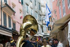 CORFU, GREECE - APRIL 29, 2016: Philharmonic musicians playing in Corfu Easter holiday celebrations. Corfu has a great tradition in music, with 18 philharmonic Royalty Free Stock Image
