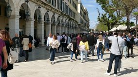 CORFU, GREECE - APRIL 6, 2018: Walking people on the Spianada square of Corfu town, Greece. Main pedestrian street Liston. Easter. Celebrations stock footage