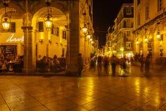 CORFU, GREECE - JULY 12, 2011: Lively night life on the main pedestrian street Liston royalty free stock photo