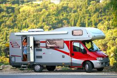 Corfu, Greece, October 18, 2018, A woman with her camper during the holidays admires the view in Paleokastritsa royalty free stock photos