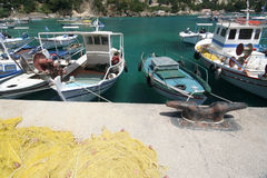 Corfu harbour in Kassiopi. Fishermen boats in the Kassiopi village harbour in the Greek island of Corfu royalty free stock photography