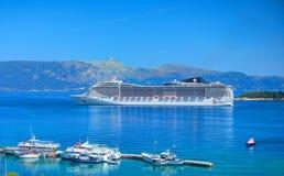 CORFU ISLAND, GREECE, JUN,06, 2014: Giant amazing white touristic passenger liner vip yachts in Ionian Sea. MSC FANTASIA cruise li royalty free stock photos