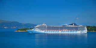 CORFU ISLAND, GREECE, JUN,06, 2014: View on giant amazing white touristic passenger liner in Ionian Sea. MSC FANTASIA cruise liner royalty free stock photography