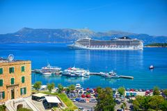 CORFU ISLAND, GREECE, JUN,06, 2014: View on giant amazing white touristic passenger liner vip yachts in Ionian Sea. MSC FANTASIA c royalty free stock photo